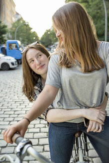 Two teenage girls together on a bicycle - OJF000108