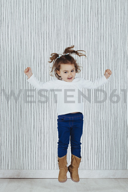 Little girl jumping in the air - ERLF000128