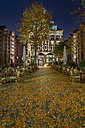 Germany, Hamburg, Restaurant terrace in the Historic Warehouse district Speicherstadt at night - NKF000456