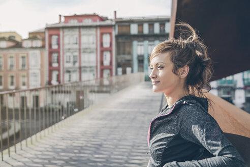 Portrait of mid adult sportive woman standing on bridge - DAPF000025