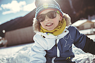 Italy, Val Venosta, Slingia, boy with sunglasses in snow - MFF002709
