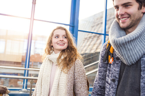 Smiling young couple at train station - HAPF000220
