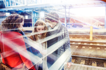 Three friends on station platform - HAPF000223