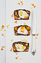 Three slices of home-baked ginger bread with cream cheese and petals of marigold - GWF004617