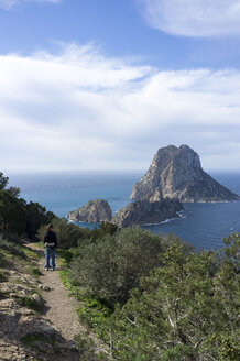 Spain, Ibiza, woman on coastal hiking trail - TKF000429