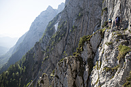 Austria, Tyrol, Wilder Kaiser, two men on via ferrata towards Goinger Halt - TKF000435