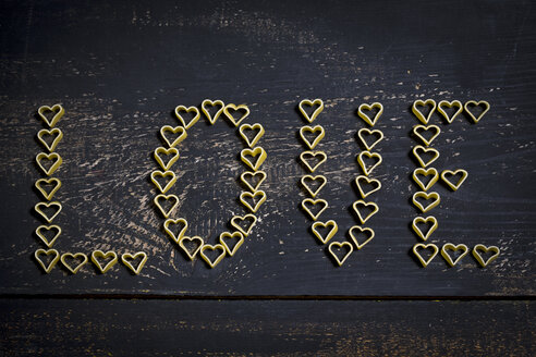Heart-shaped noodles forming the wotd 'Love' on wood - MAEF011278