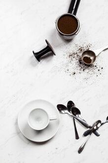 Empty espresso cup, spoons and pressurized portafilter on white marble - SBDF002687