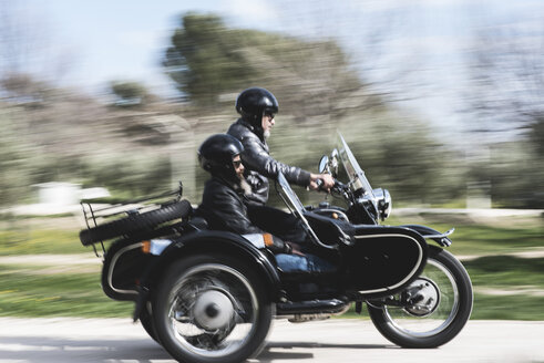 Two bikers driving with their sidecar motorcycle - JASF000407