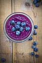 Glass of chia blueberry pudding on wood - LVF004516