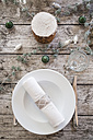 Place setting on laid table at Christmas time - LVF004523
