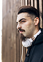 Portrait of stylish young man with headphones - MGOF001435