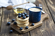 Stack of mini pancakes, blueberries and cup of coffee - SARF002548