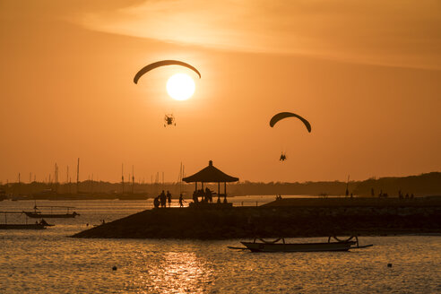 Indonesia, Bali, paragliders during sunset over the beach in Sanur - PCF000237
