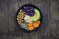 Bowl of quinoa, avocado, roasted chick-peas, sweet potato, red cabbage and hummus - LVF004533