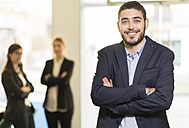 Portrait of confident young man in office - JASF000491