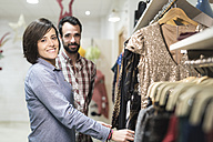 Portrait of couple shopping in fashion store - JASF000501