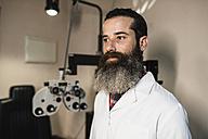 Portrait of optometrist in examination room - JASF000510
