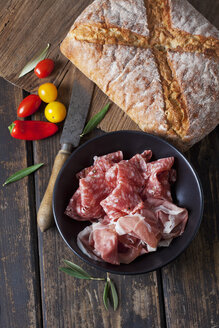 Ciabatta bread with ham and salami, tomatoes and mini capsicum on wood - CSF027166