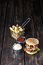 Large hamburger with fries, mayonnaise and ketchup - CSF027193