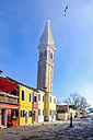 Italy, Veneto, Burano, view to tilted tower and colourful row of houses at sunlight - HAMF000148