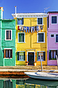 Italy, Veneto, Burano, view to three colourful houses at sunlight - HAMF000151