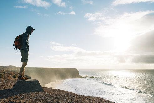 Spain, Canary Islands, Fuerteventura, El Cotillo, man looking at view - GEMF000726