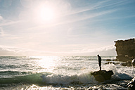 Spain, Fuerteventura, La Pared, silhouette of a man standing on a rock at surf - GEMF000729