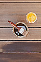 Applying glaze with brush on floorboards - GWF004628