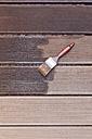 Applying glaze with brush on floorboards - GWF004631