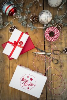 Christmas decoration and wrapped presents on wood - LVF004547