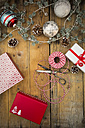 Christmas decoration and wrapped presents on wood - LVF004550