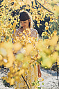 Young woman with bouquet in autumnal nature - MJF001716