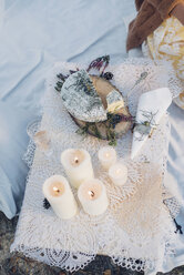 Glass of champagne, plate with soft cheese and lighted candles on lace - MJF001731