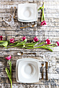 Two place settings on table decorated with tulips - SARF002576