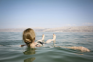 Israel, woman floating on water of the Dead Sea - REAF000058