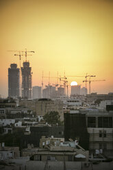 Israel, Tel Aviv, cityscape with cranes at sunset - REAF000076