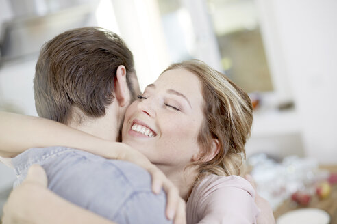 Young couple hugging - FMKF002399