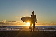 Surfer at sunrise on the beach - SKCF000065