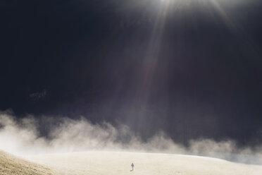 Germany, Bavaria, Berchtesgadener Land, mountain, boy on meadow in winter - MJF001742