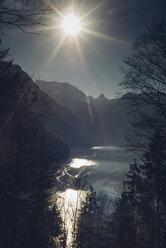 Germany, Bavaria, Berchtesgadener Land, Alps, Winter, Koenigssee, Malerwinkel against the sun - MJF001748