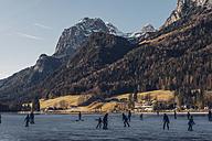 Germany, Bavaria, Berchtesgadener Land, Ramsau, Lake Hintersee, frozen lake and ice skater - MJ001751