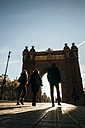 Spain, Barcelona, view to Arc de Triomphe with three pedestrians in the foreground - KIJF000180