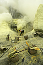 Indonesia, Java, Sulphur miners working in the crater at Kawah Ijen - DSG000985