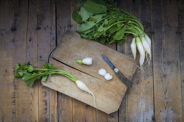 Sliced and whole white beer radish on wooden board - LVF004571