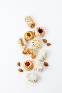 Different sorts of Italian almond cookies and almonds on white background - CSF027229