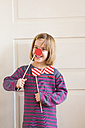 Portrait of little girl with toy bow and red nose - LVF004572