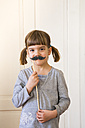 Portrait of little girl with toy moustache - LVF004575
