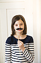 Portrait of girl with toy moustache - LVF004578