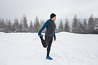 Man warming up for cross country run in winter - HAPF000245